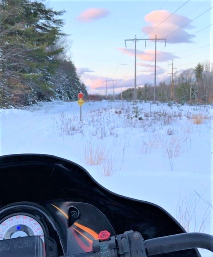 photovoice - snowmobile facing trail ahead